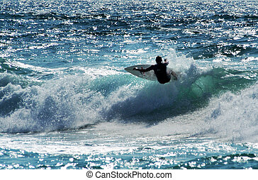 Sea Sport - Wave Surfing - Wave surfer surfing wave at sea.