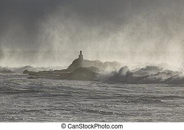 Portuguese coast geodesic landmark covered by sea spray