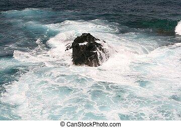 Sea spray roaring against rock on Lanzarote coastline