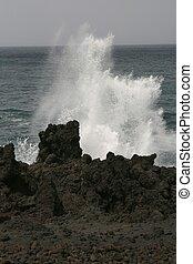 Sea roaring against volcanic cliffs on Lanzarote coastline