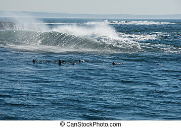 The view of the wind blowing the waves to cause spray, Cape Town, South Africa