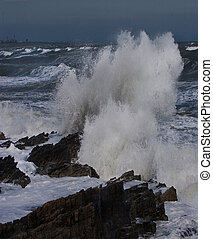 Waves breaking on the shore on the East coast of Ireland.