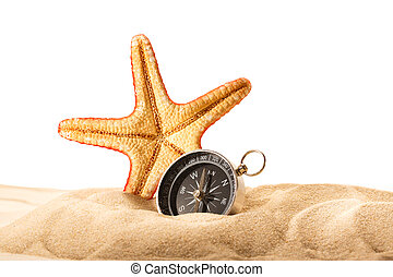 Sea star and compass in sand