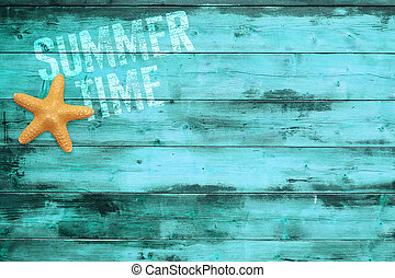 sea star on turquoise wood