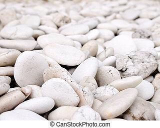 sea stone naturally polished white rock pebbles background