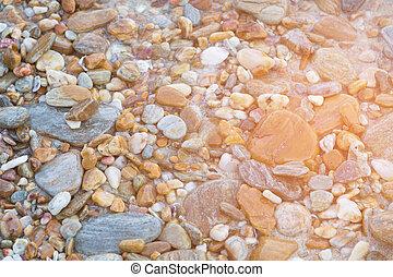 Sea stone on the beach