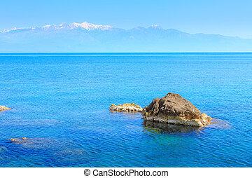 Sea, stone, snow mountains, Peloponnese, Greece - Blue sea ...