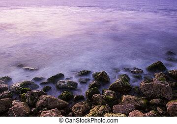 Sea stones at sunset in