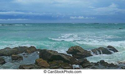 Sea stormy landscape over rocky coastline