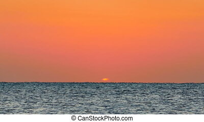 sea sunrise - shot with telephoto lens