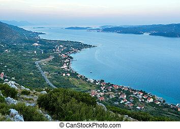 Sea sunset and village on seashore (Pelješac peninsula, Croat