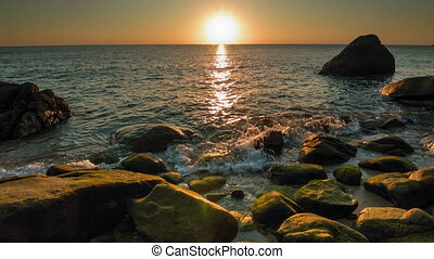 Sea sunset on the rocky shore 2 - Orange sunset on the rocky...