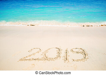Inscription on the sand, celebrate the new year in the ...