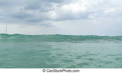 Sea surf at Nai Harn beach, Phuket island, Thailand.