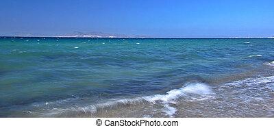 Sea surf - Beautiful blue sea with a waves hitting the beach