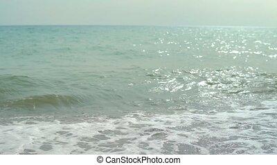 Sea surf, beautiful waves, on the pebble beach beat,. slowly...