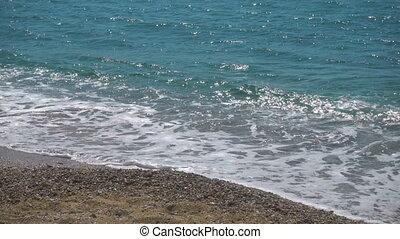 Sea surf of Aegean Sea. Mykonos Island, Greece