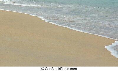 Sea surf on a clean sandy beach. Video UltraHD