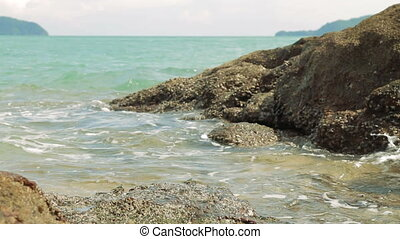 Sea surf on Laem Ka Noi beach. Phuket island, Thailand.