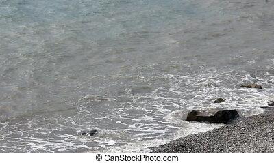 Sea surf on stony coast