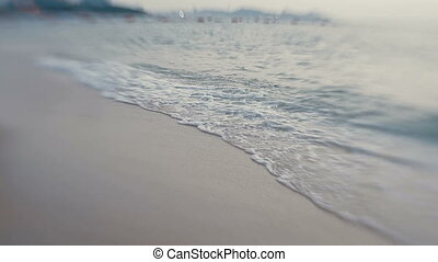 Sea surf. Waves lapping on the beach. Pattaya, Thailand. Shooted with Lens Baby Sweet 35mm