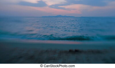 Sea surf. waves lapping on the sand shore. Pattaya,...
