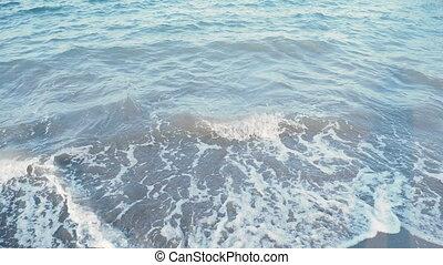 Sea surf. Waves lapping on the sandy beach. Kemer, Turkey.
