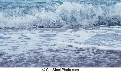 Sea surf. Waves runs on coastal pebble. slow motion.