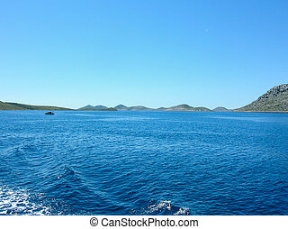 Sea surface aerial view. Background shot of clear sea water surface. Blue sea water in calm. Sea texture. Background blue waves.