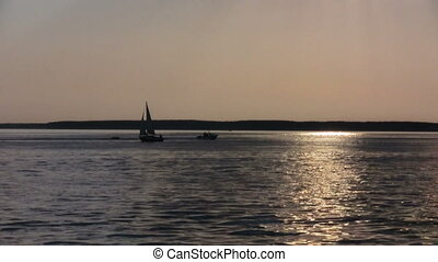 Sea surface with calm waves and buoy over sunset