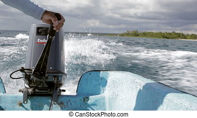 Sea traveling by motor boat on high speed