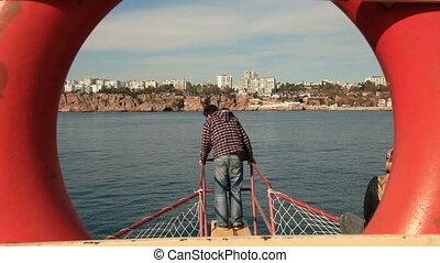 Sea trip (editorial) - Tourist couple doing romantic sea...