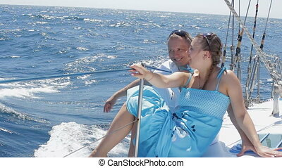 Sea trip. HD - Young boy with girlfriend are riding on a...