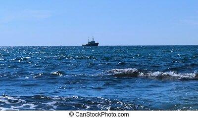 Sea tug on the horizon - Sea tow moving slowly on the...