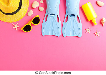 Sea vacation accessories on yellow background, top view