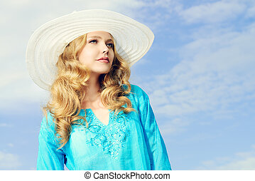 sea vacation - Portrait of a charming girl in elegant hat...