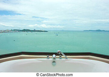Sea view from restroom with bathtub