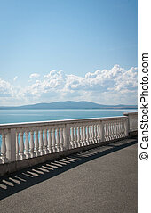 sea view from the waterfront with white fence