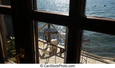 Sea view from the window of a cafe.