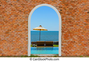 Sea view inside on the brick wall