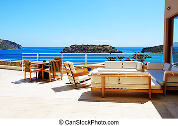 Sea view terrace at luxury hotel with a view on Spinalonga Island, Crete, Greece