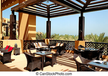 Sea view terrace of outdoor restaurant at luxury hotel, Ras ...