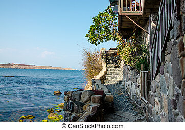 sea view with stone wall and stairway in sozopol, bulgaria