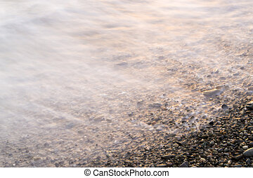 Sea Water Blurs - Sea blurs in movement as stones gather the...
