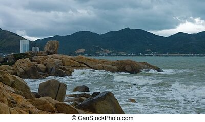 Warm, foamy waves of tropical sea water spash over the Hon Chong Rocks, an attraction in Nha Trang, Vietnam. Video 3840x2160