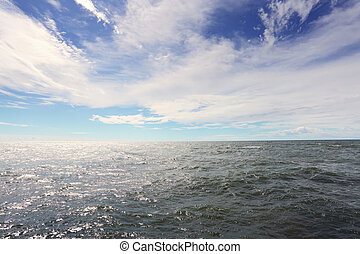Sea water under a blue sky
