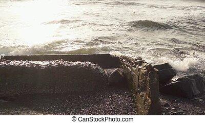 Sea wave crashes on concrete reinforcement slow mo - Slow...