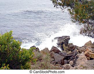 Sea wave on rocks
