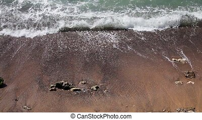 Sea wave on the sand