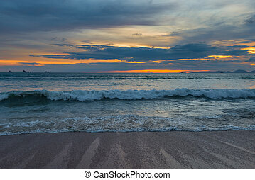 sea waves and beautiful sunset over the Andaman Sea in Thailand
